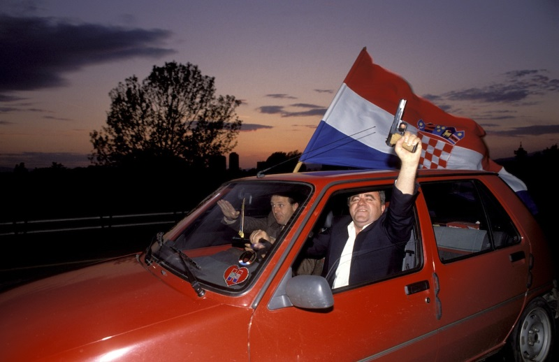 Civilians waving the Croat flag celebrate the vote in favour of independence for Croatia from the former Yugoslavia.